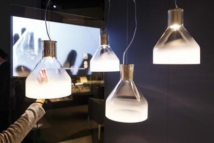 I pezzi iconici e le novità 2015 dell'azienda presentate in uno stand di 880 mq progettato da Ferruccio Laviani