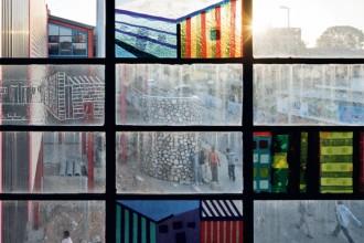 """L'Alexandra Intepretation Centre è ubicato di fronte alla semplice baracca (""""yard"""" in gergo locale)"""