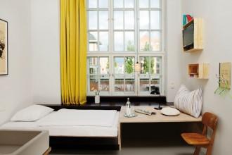 Una divisione ottimale degli spazi si abbina ad un'estetica pulita e alla scelta di materiali naturali