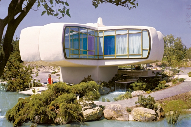 Subject: House of Tomorrow, Built by M.I.T, Monsanto Chemical Company and exhibited at Disneyland.  This experimental house consists of 20 molded pieces and lies on a 16 square foot block of concrete. The house is 1300 square feet and everything is molded plastic.  Anaheim, California 1957 Photographer- Ralph Crane TIme Inc Owned- Staff merlin-1151974