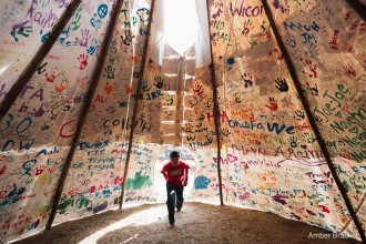 Oceti Sakowin - Oceti Sakowin, or the Seven Council Fires, is the true name of the great Sioux nation and refers to the coming together of the different factions of the tribe.  Oglala, Cheyenne, Ut, Cree, Hopi and non-indigenous all are among the 200+ tribes represented in the camps and on the front lines. The last time there was a similar gathering was before the Battle of the Little Bighorn, 1876.   Jesse Jaso, 12, enters the Unity Teepee, at the Sacred Stone Camp near Cannonball, ND on Saturday, September 10, 2016. The teepee is signed by camp supporters from all over North America and around the world. Amber Bracken for Buzzfeed News
