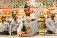Francesco Pirelli crafts a Black & White Manhattan, a specialty cocktail at the Arriviamo Bar in the Starbucks Reserve Roastery in Milan on September 3, 2018. (Suzie Reecer, Starbucks)