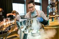 Starbucks barista Cecilia Cacciatore operates a nitro ice cream maker at the Affogato Station at the Starbucks Reserve Roastery in Milan, Italy on Monday, August 03, 2018. (Joshua Trujillo, Starbucks)