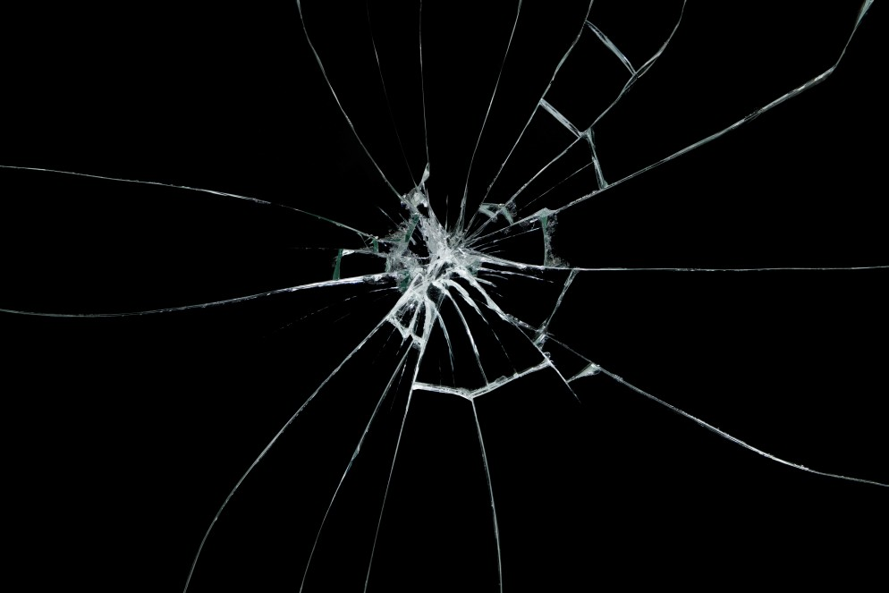 Broken glass on black background