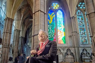 LONDON, ENGLAND - SEPTEMBER 26: Artist David Hockney poses in front of The Queen's Window, a new stained glass window at Westminster Abbey he designed and which was created by Barley Studio York, as it is revealed for the first time on September 26, 2018 in London, England. The window - the artist's first work in stained glass - reflects the Queen's love for and connection with the countryside.  (Photo by Victoria Jones - WPA Pool/Getty Images)