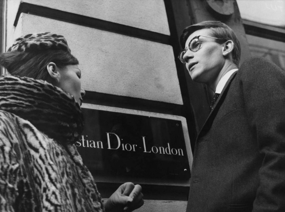 French fashion designer Yves Saint Laurent (1936 - 2008) in London, 11th November 1958. He is preparing for the following day's Dior Autumn collection show to an audience including Princess Margaret, at Blenheim Palace. (Photo by Popperfoto/Getty Images)