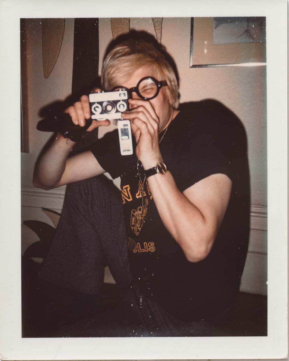 Andy Warhol, David Hockney, ca. 1972, Polaroid, 10.7 x 8.5 cm. © 2018 The Andy Warhol Foundation for the Visual Arts, Inc. Licensed by DACS, London. Courtesy BASTIAN, London
