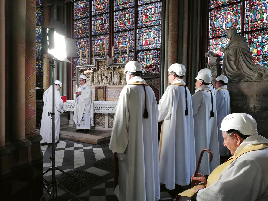 First mass in side chapel of Notre-Dame de Paris after fire