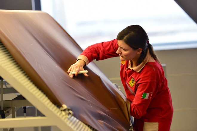 An employee cheks leather pieces in the upholstery department of the Ferrari factory on December 5, 2012 in Maranello. The Ferrari 45 buildings's factory, where more than 3,000 workers produce the company's GT and Formula 1 cars is based in Maranello. AFP PHOTO / GABRIEL BOUYS        (Photo credit should read GABRIEL BOUYS/AFP via Getty Images)