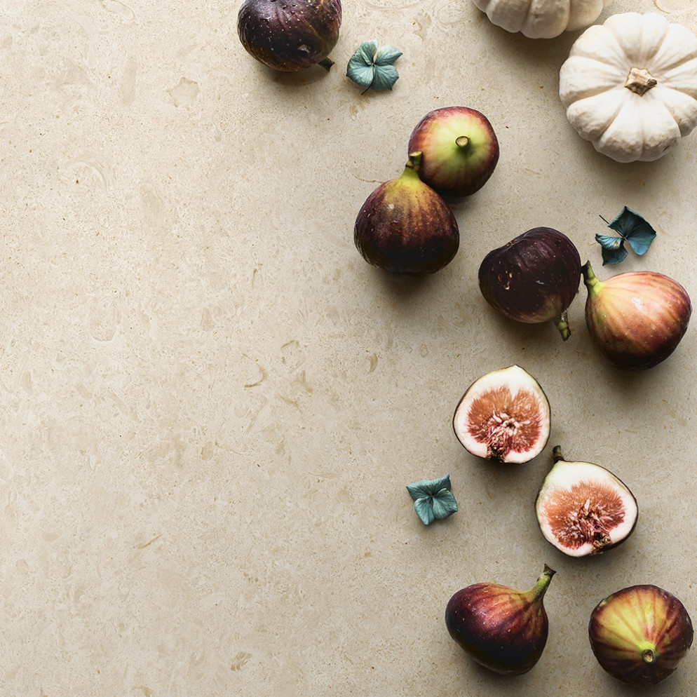 Overhead view of figs and pumpkins on table