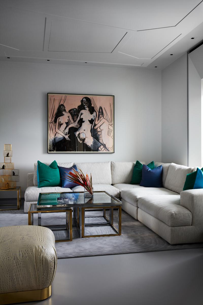 divano-grigio-abbinare-cuscini-tappeto-DAquinoMonacoCPS_casa-new-york-living-corriere
