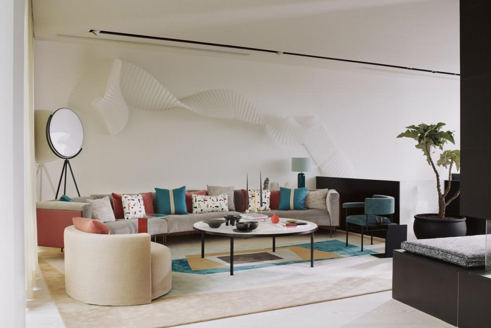 divano-grigio-abbinare-cuscini-tappeto-attico-modernista-TVC-Waldo-Works-living-corriere