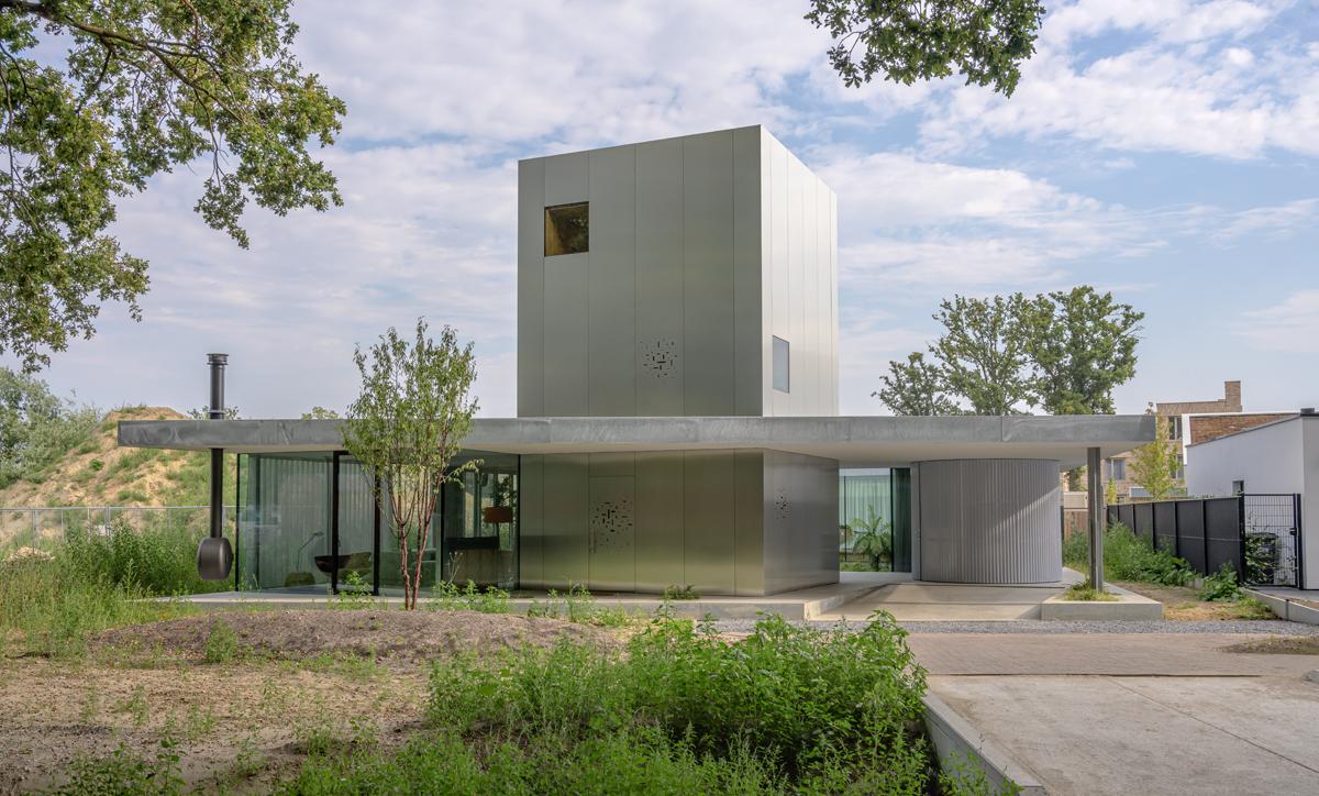 Metà casa e metà giardino: in Olanda una villa nella natura - Foto