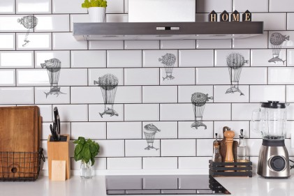 Modern kitchen with brick white tile wall and differet utensils