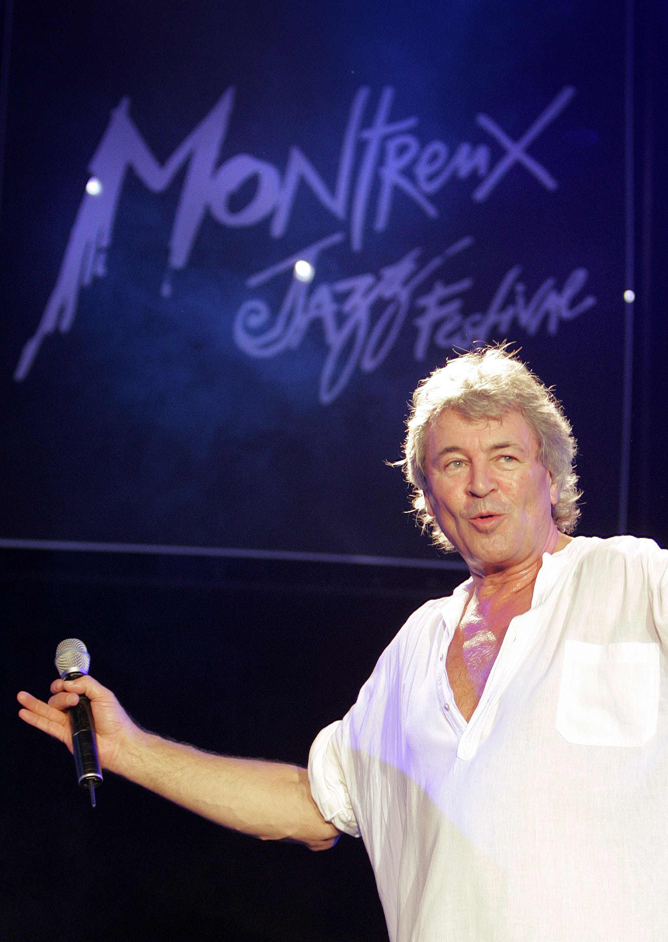 Ian Gillan of the English rock band Deep Purple performs in the Auditorium Stravinski, during the closing night of the 40th Montreux Jazz festival, 15 July 2006 in Montreux. Deep Purple's most famous song 'Smoke on the Water' tells the true story of the fire which burned on December 1971 the Montreux Casino during Frank Zappa's concert, and Deep Purple's difficulties recording their Machine Head album. AFP PHOTO / FABRICE COFFRINI (Photo credit should read FABRICE COFFRINI/AFP via Getty Images)